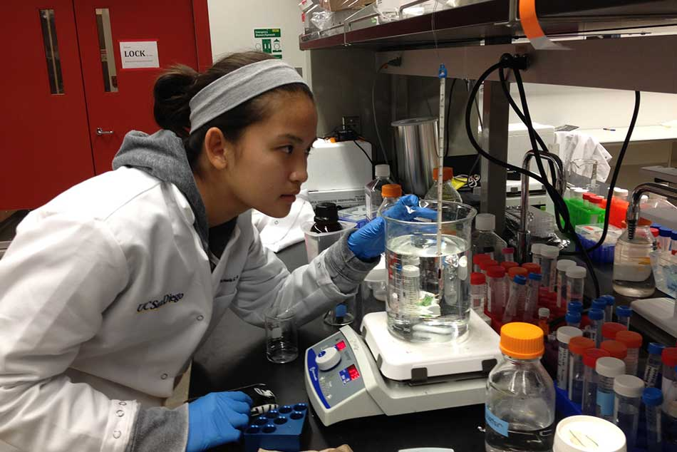Maggie Chen working in a science lab